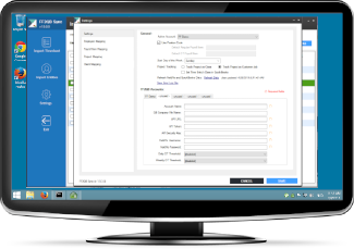 Desktop monitor showing custom QuickBooks data sync application built by Pell Software for Windows 10